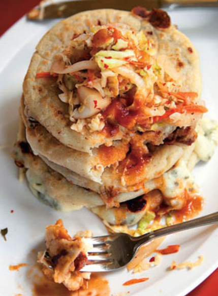 A pupusa is a thick griddle cake or flatbread from El Salvador and Honduras, made with cornmeal or rice flour, similar to the Venezuelan and Colombian arepa. In El Salvador, it has been declared the national dish and has a specific day to celebrate it.